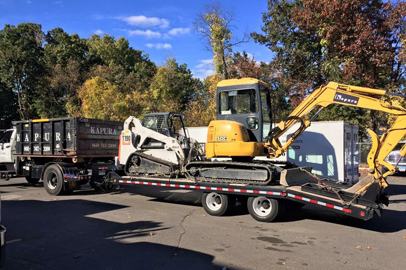 Backhoe and Bobcat Transporting